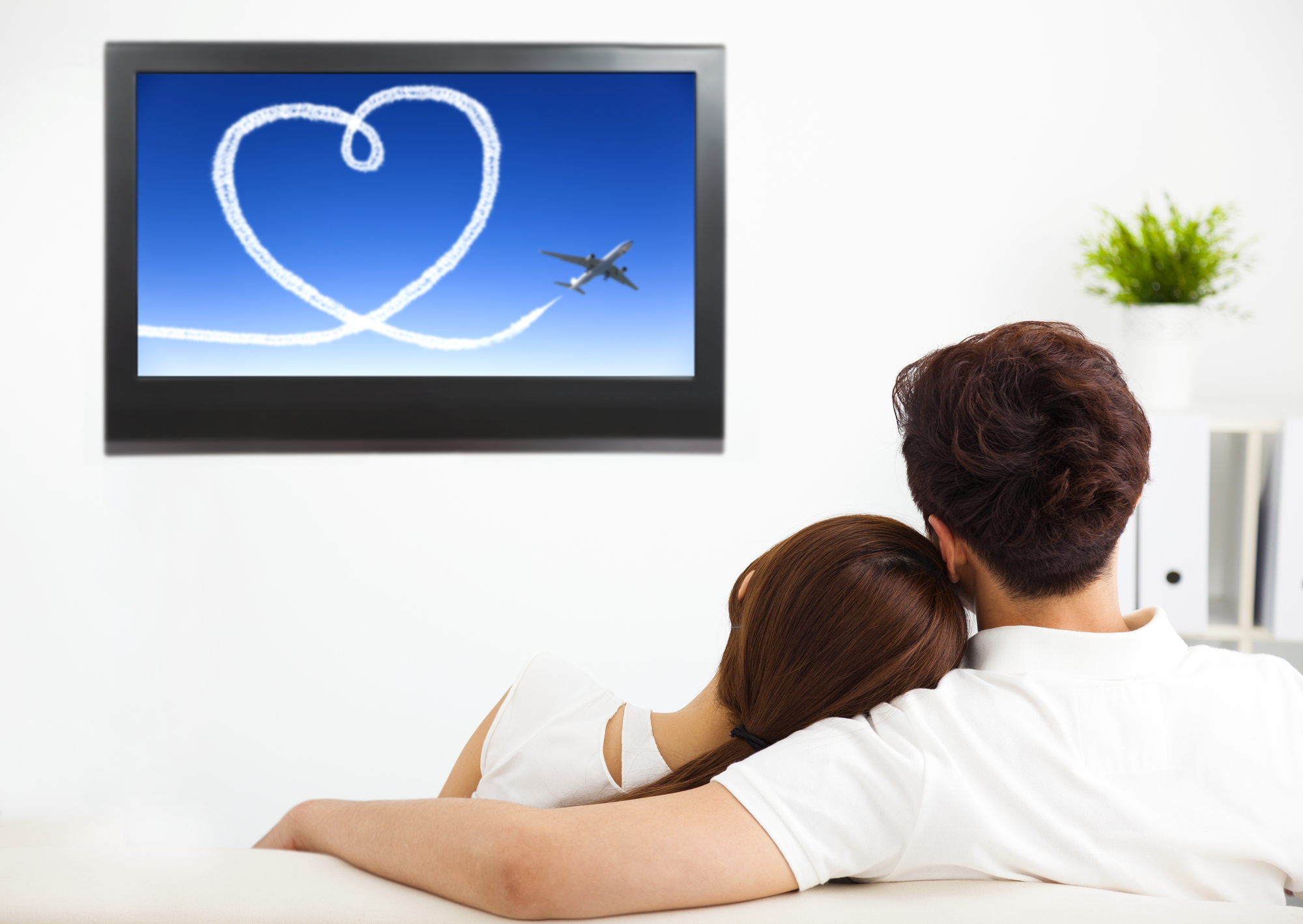 young couple watching the  tv show in living room